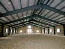 Covered riding arena building in prefab steel