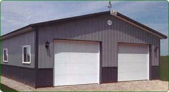 Prefab steel building with pitched, peaked roof